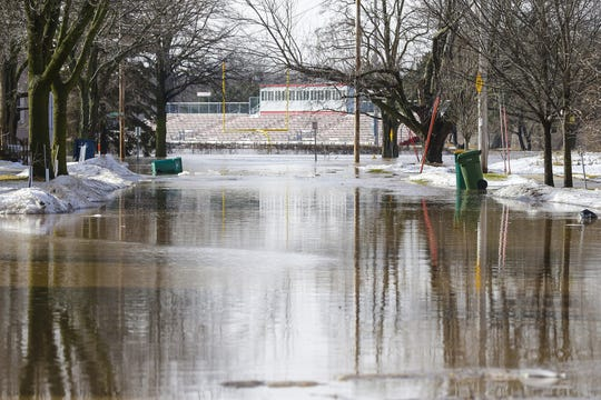 Fruth Field can be seen in the background Thursday, March 14, 2019, of a flooded Oak Street in Fond du Lac, Wis. Ice jams on the east branch of the Fond du Lac River caused localized flooding problems in the city.