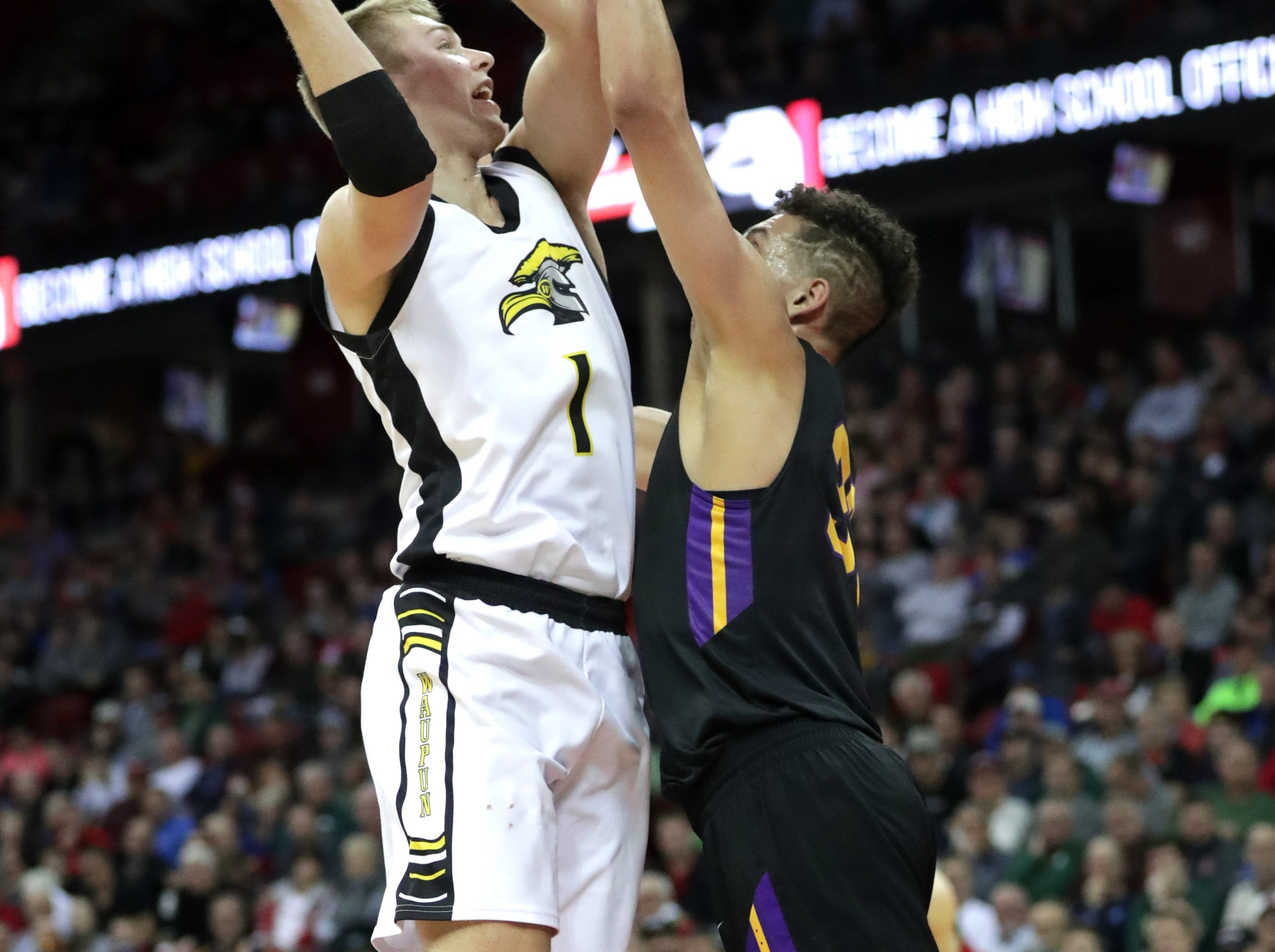 Denmark High School's #33 Patrick Suemnick against Waupun High School's #1 Marcus Domask during their WIAA Division 3 boys basketball state semifinal on Thursday, March 14, 2019, at the KohlCenter in Madison, Wis.