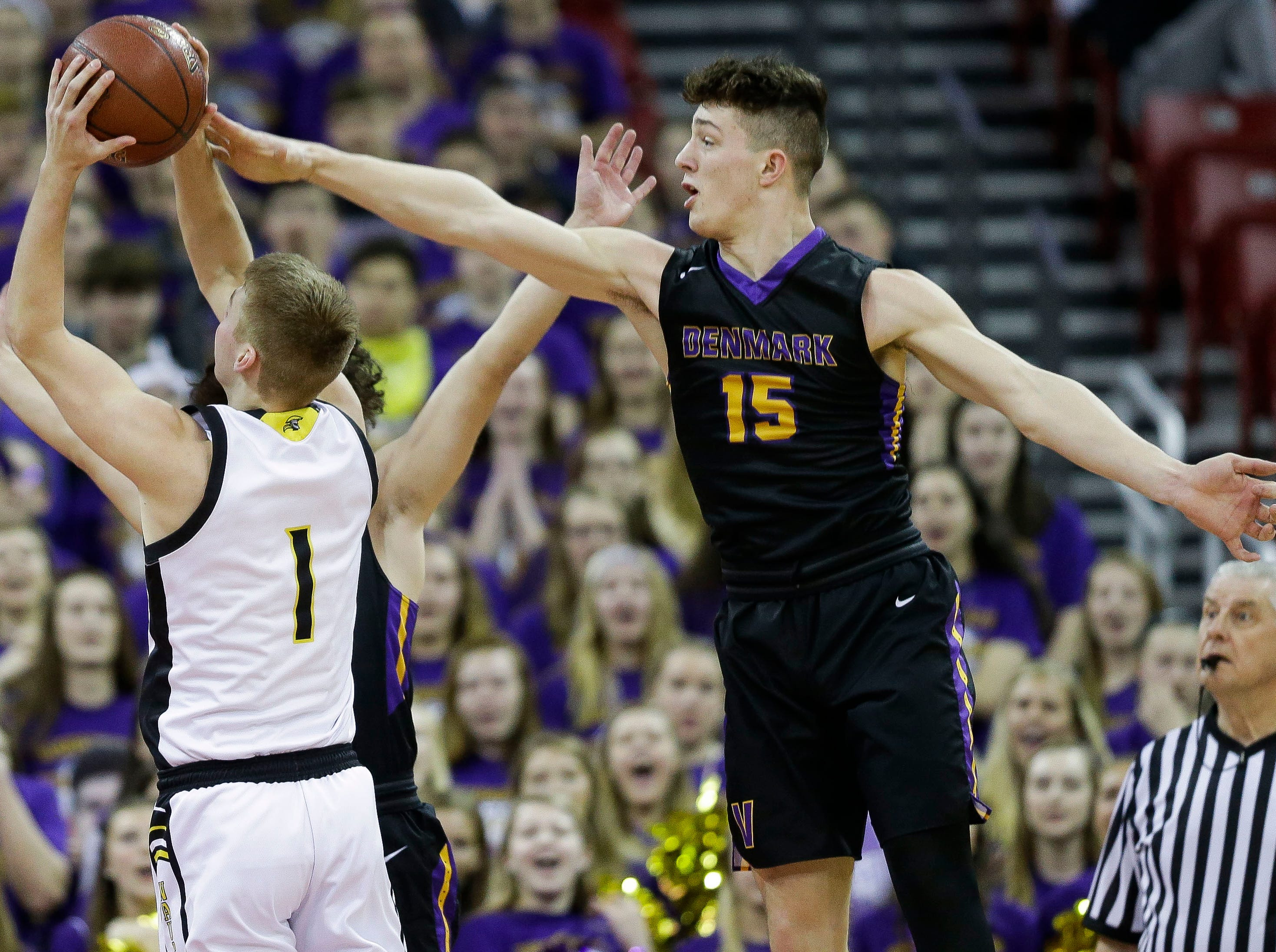 Denmark High School's Zane Short (15) contests a shot by Waupun High School's Marcus Domask (1) in a Division 3 boys basketball state semifinal on Thursday, March 14, 2019, at the Kohl Center in Madison, Wis.
