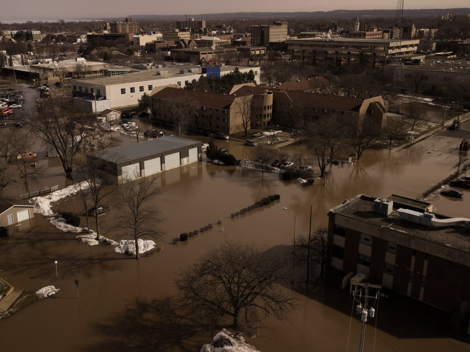 Western Avenue is pictured under water after ice jams caused flooding from the Fond du Lac River on Thursday, March 14. This photo was taken by drone at around 11 a.m.