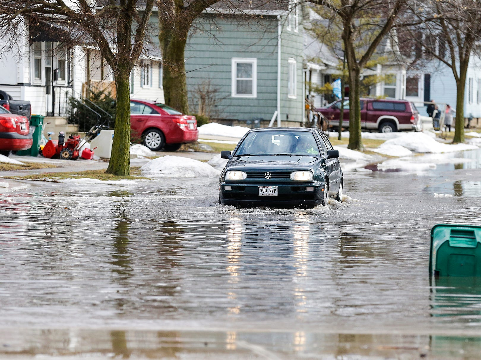 A car drives in high water Thursday, March 14, 2019 on Chestnut Street in Fond du Lac, Wisconsin. Ice jams on the east branch of the Fond du Lac River and heavy rainfall caused flooding problems throughout the city.