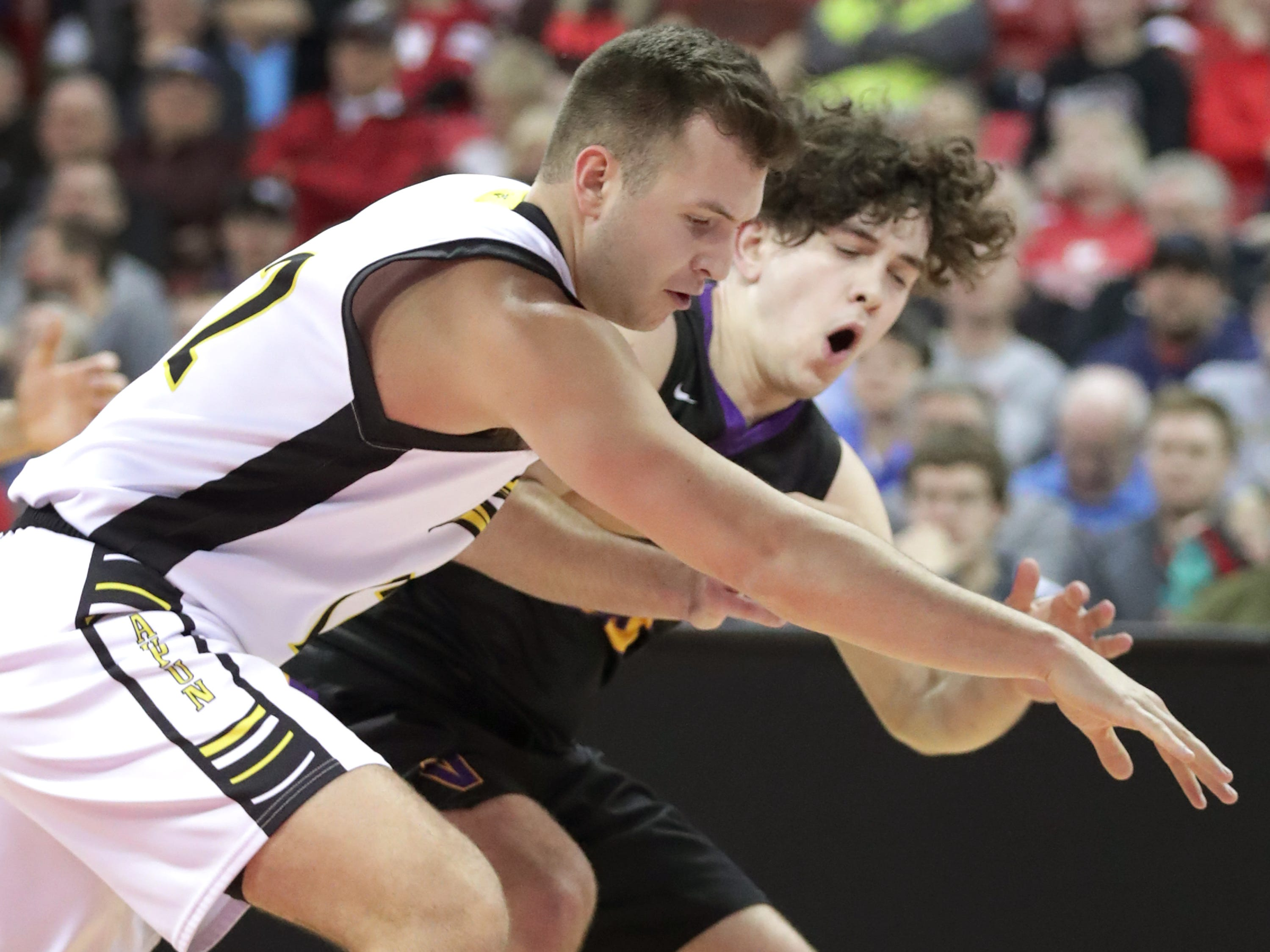 Denmark High School's #23 Brady Jens, back, against Waupun High School 's #22 Jaden Collien during their WIAA Division 3 boys basketball state semifinal on Thursday, March 14, 2019, at the KohlCenter in Madison, Wis.  Waupun defeated Denmark 60 to 43.