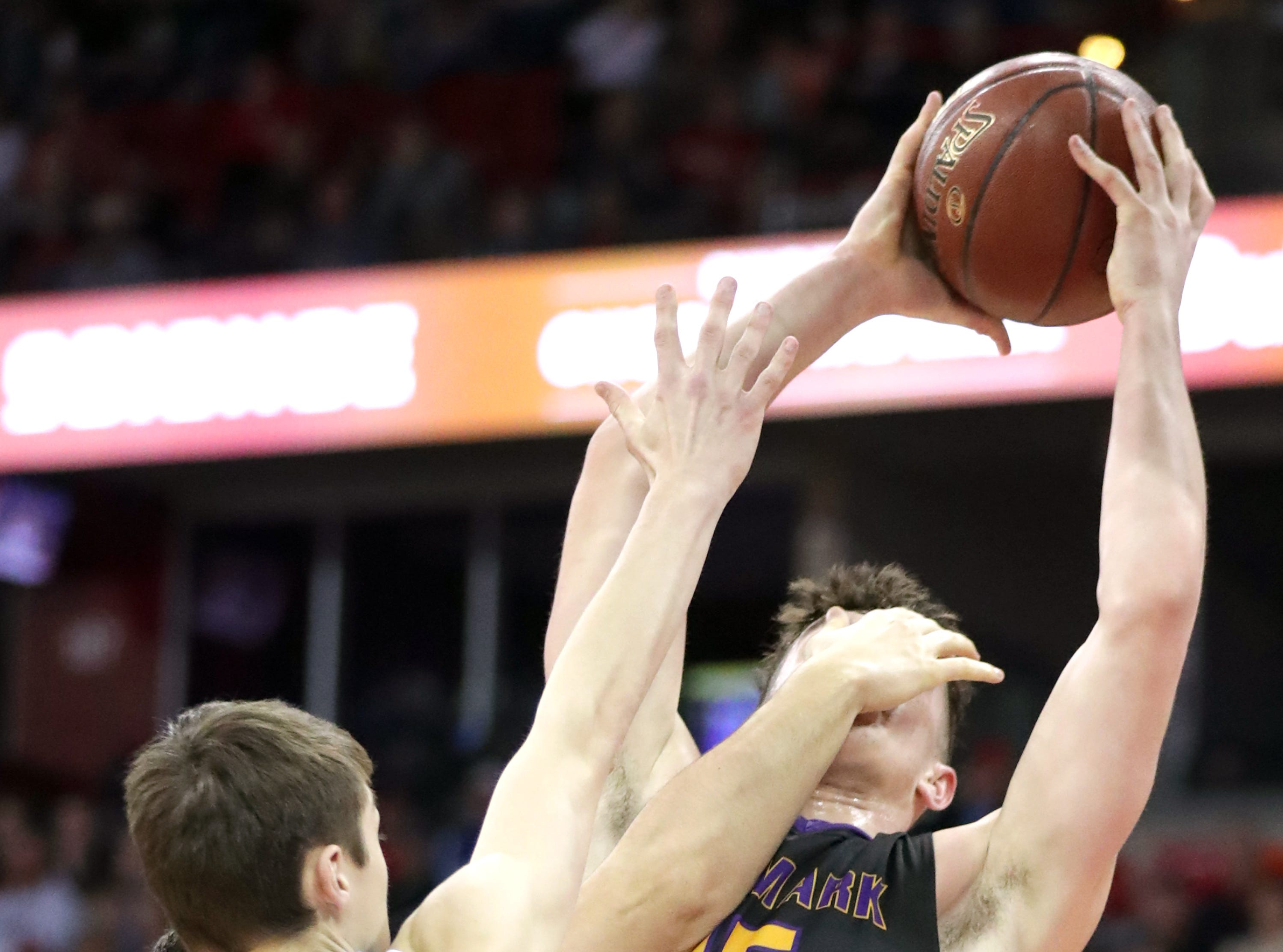 Denmark High School's #15 Zane Short against Waupun High School's #12 Tyler Wiese during their WIAA Division 3 boys basketball state semifinal on Thursday, March 14, 2019, at the KohlCenter in Madison, Wis.  Waupun defeated Denmark 60 to 43.