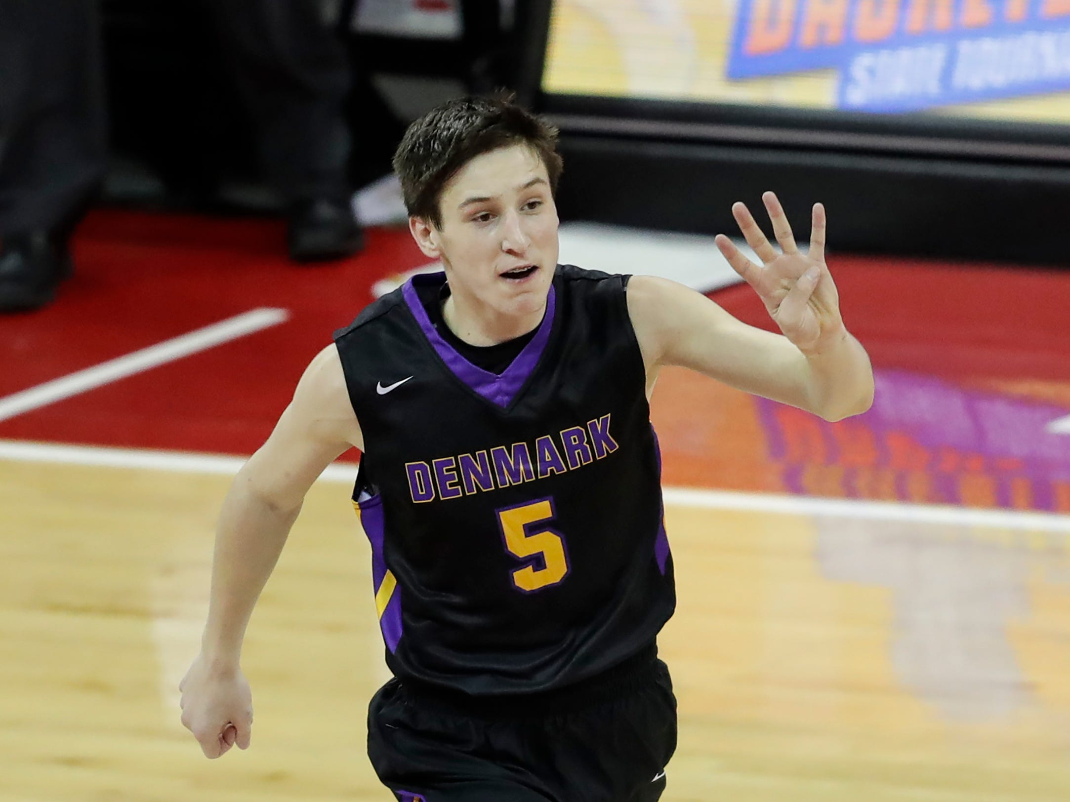 Denmark's Brennen Miller (5) reacts after sinking a three point shot against Waupun's during their WIAA Division 3 boys basketball state semifinal at the Kohl Center Thursday, March 14, 2019, in Madison, Wis.