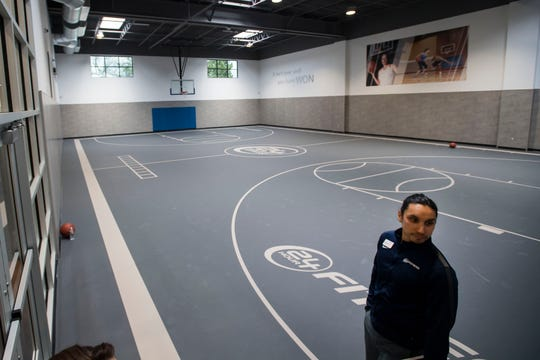 Regional fitness director Keita Pakawongse gives a tour of the basketball court on Thursday, March 14, 2019, at 24 Hour Fitness at the corner of East Mulberry Street and South College Avenue in Fort Collins, Colo.