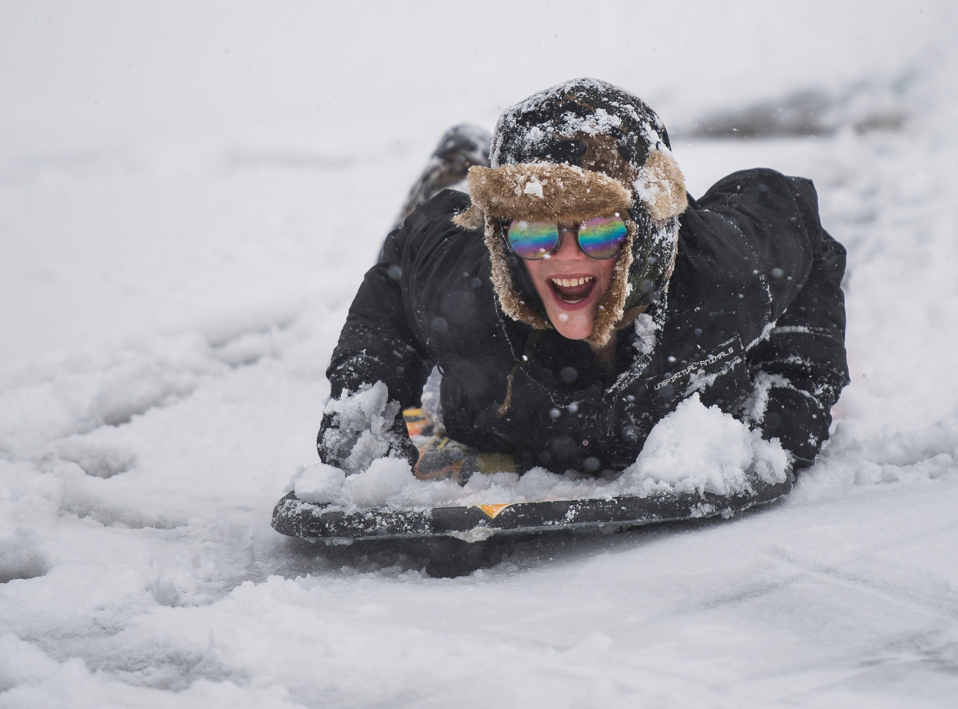 Morgan Warr, 12, drops into the bowl on a sled at Edora Park on Wednesday, March 13, 2019, in Fort Collins, Colo.