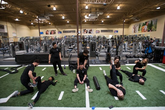 Certified personal trainers stretch on Thursday, March 14, 2019, at 24 Hour Fitness at the corner of East Mulberry Street and South College Avenue in Fort Collins, Colo.