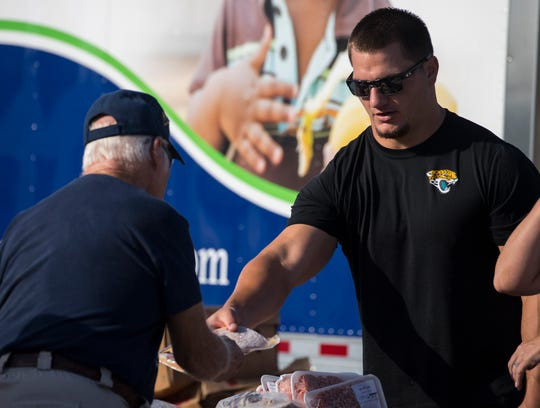 Professional football player Tommy Bohanon helps distribute food to veterans Thursday morning, 3/14/19, at the Lee County Va Healthcare Center in Cape Coral. The Community Cooperative Inc. and iMold also teamed up to serve. Bohanon will be the guest speaker for the Southwest Florida Sports Awards in May 21 at Barbara B. Mann where The News-Press and Naples Daily News will honor the areas top high school athletes.