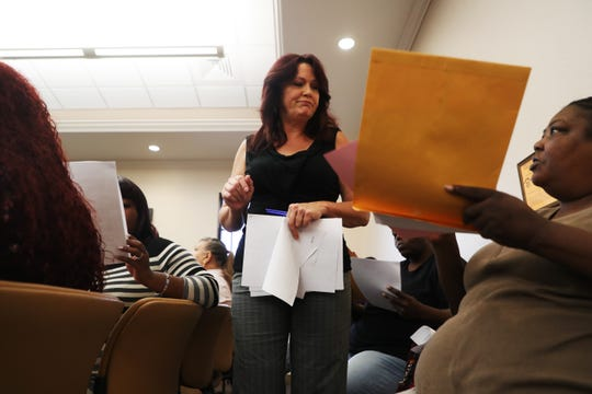 Diana Jones, an employee of Fort Myers Housing Authority, assists residents of Sunrise Towers who are being relocated with tenant protection vouchers.