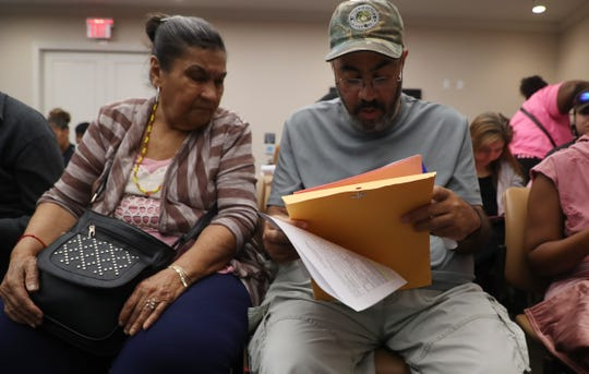 Sunrise Tower residents, Louisa Rivera and her son, Edward Colon attend a family briefing for the housing choice program  Thursday 3/14/2019. Sunrise Towers residents are being relocated with tenant protection vouchers. The owner has decided not to renew section 8 contract with HUD so the housing authority of Fort Myers has stepped in to offer assistance.