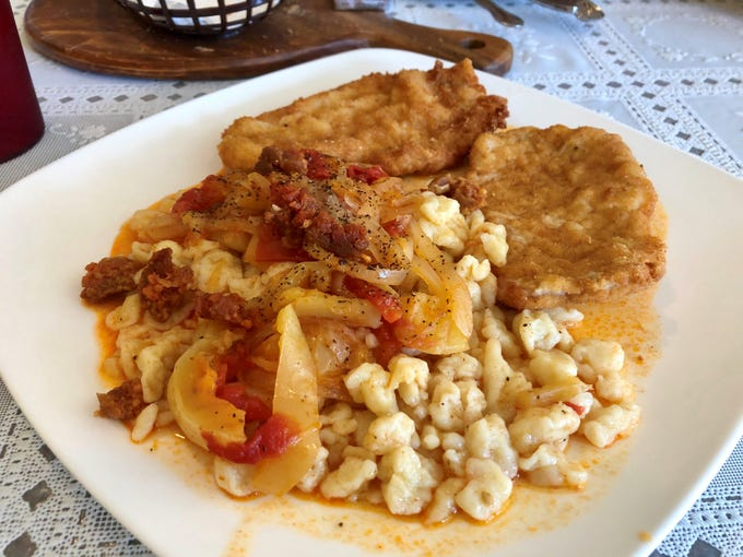 Schnitzel with noodles, peppers and spicy sausage from Hungarian Kitchen.