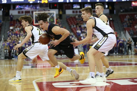 Denmark's Brady Jens drives past Waupun's Conner Kamphuis during Thursday's WIAA Division 3 boys state basketball semifinal at the Kohl Center in Madison.