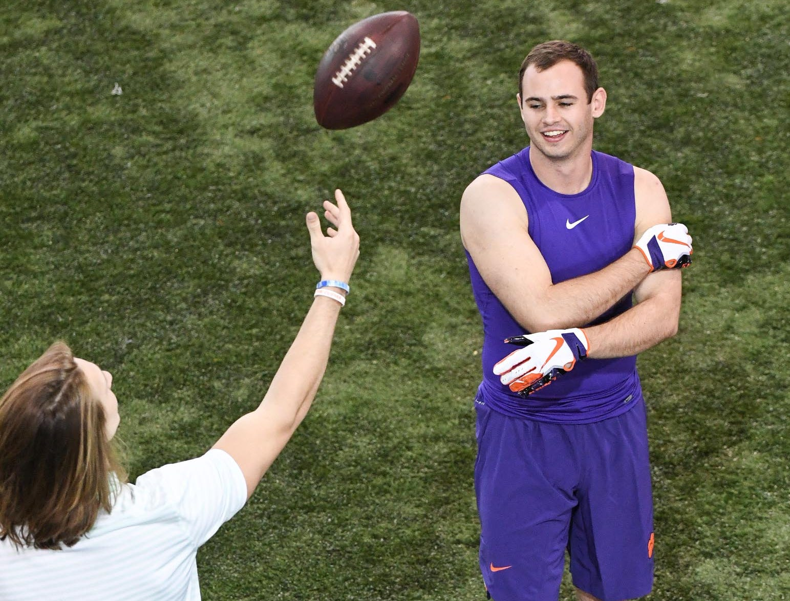 Wide receiver Hunter Renfrow watches former teammate and Clemson quarterback Trevor Lawrence toss a ball in the air during Clemson pro day at the Poe Indoor Facility in Clemson Thursday, March 14, 2019.