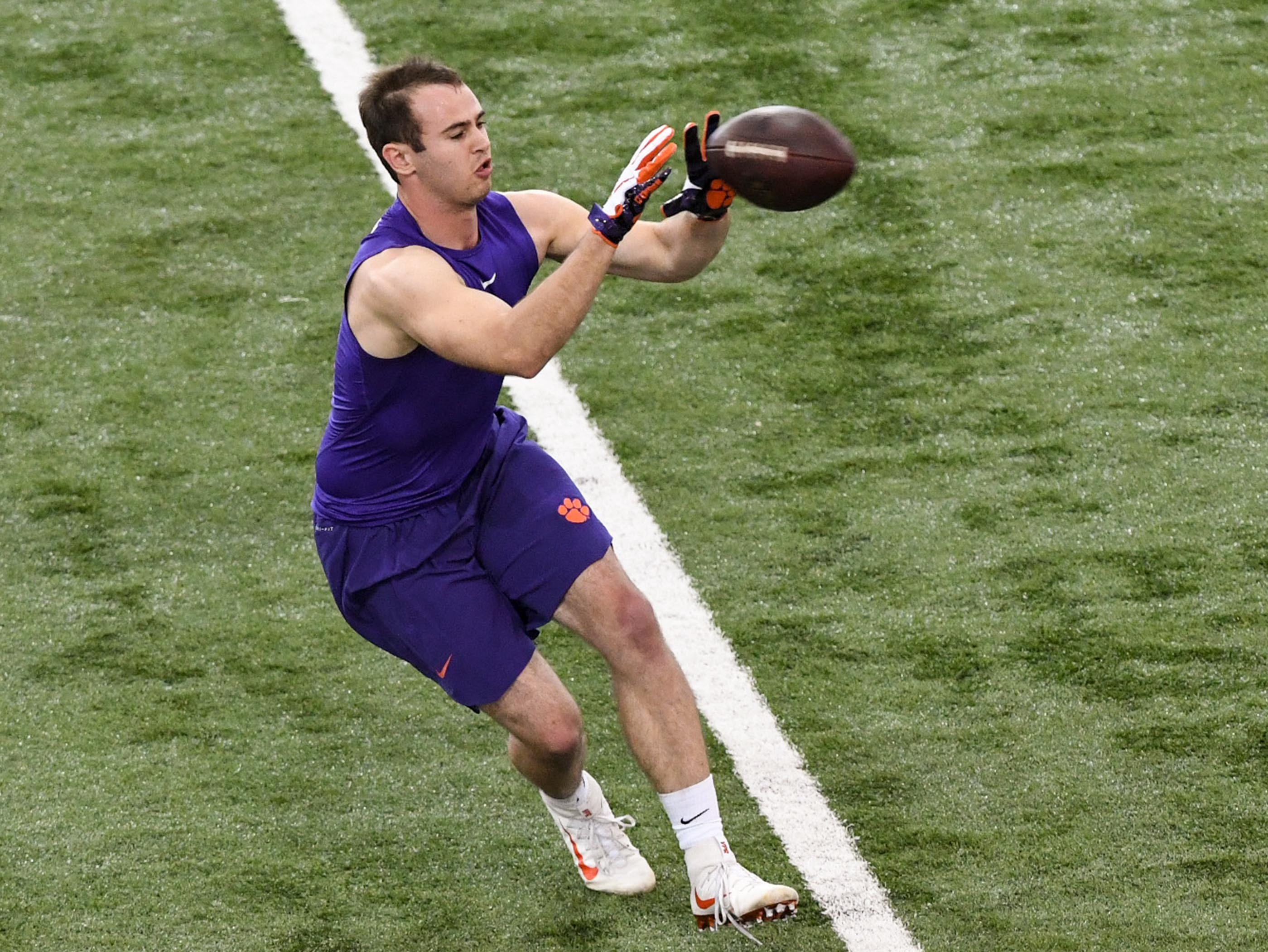 Wide receiver Hunter Renfrow catches a ball during Clemson pro day at the Poe Indoor Facility in Clemson Thursday, March 14, 2019.