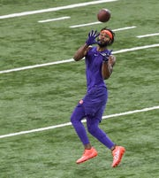Wide receiver Trevion Thompson catches a long pass during Clemson pro day at the Poe Indoor Facility in Clemson Thursday, March 14, 2019.