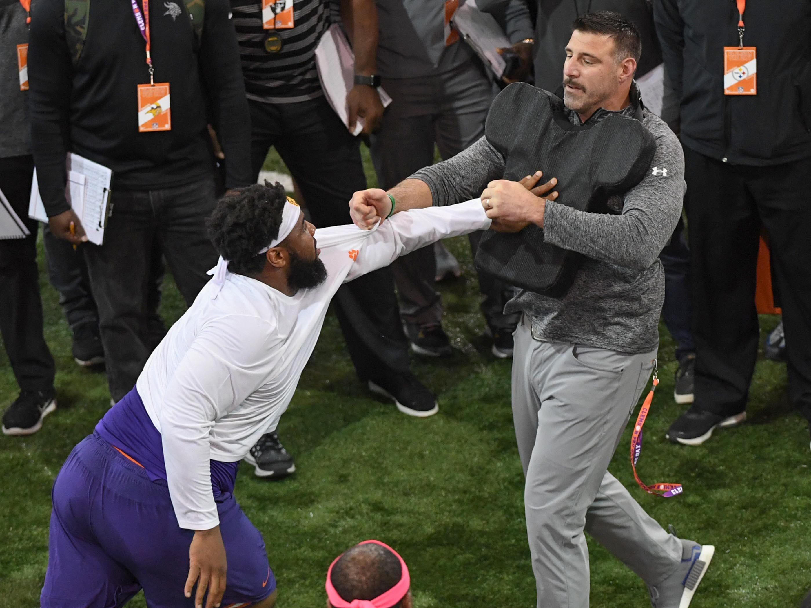 Defensive lineman Christian Wilkins in a drill with Mike Vrabel during Clemson pro day at the Poe Indoor Facility in Clemson Thursday, March 14, 2019.