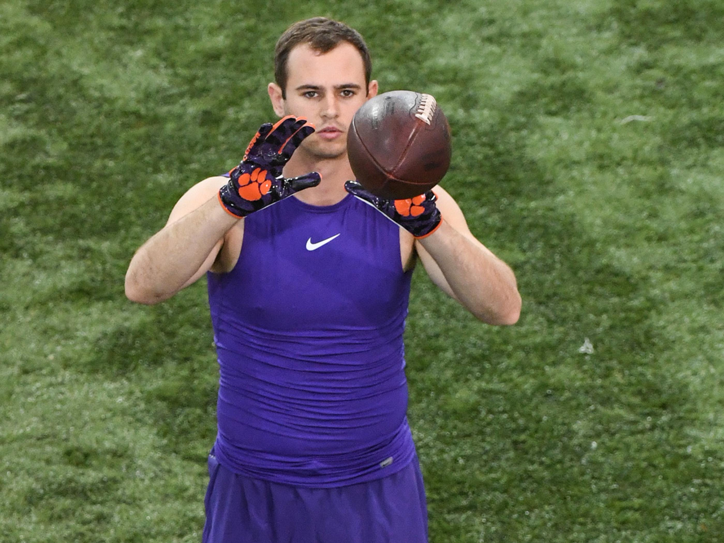 Wide receiver Hunter Renfrow catches a ball from Trevor Lawrence warming up for Clemson pro day at the Poe Indoor Facility in Clemson Thursday, March 14, 2019.
