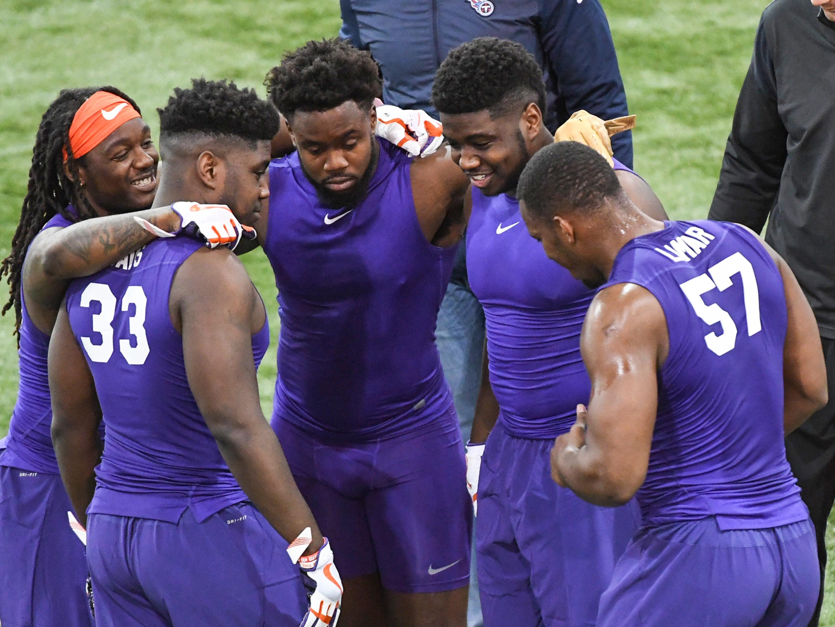 Clemson linebackers huddle during Clemson pro day at the Poe Indoor Facility in Clemson Thursday, March 14, 2019.