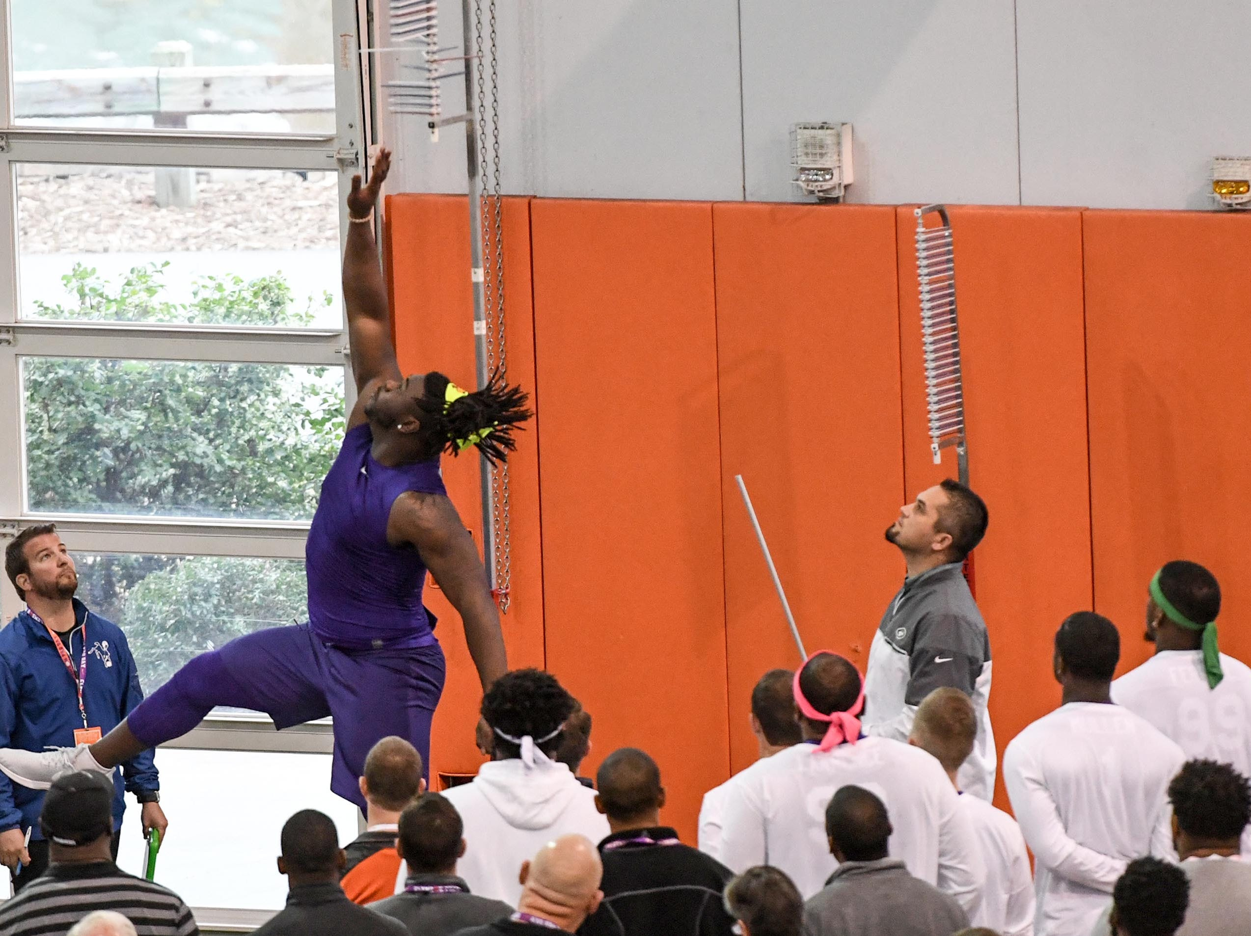 Defensive lineman Albert Huggins Jr. leaps 28.5 inches in a vertical leap test during Clemson pro day at the Poe Indoor Facility in Clemson Thursday, March 14, 2019.
