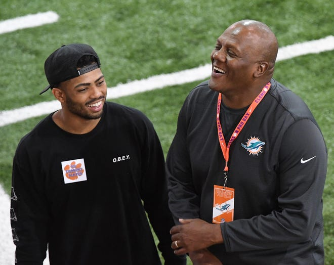 Marion Hobby visited with Darien Rencher during the Clemson Pro Day in 2019. Hobby, who previously coached for Clemson, has spent the past two seasons with the Miami Dolphins.
