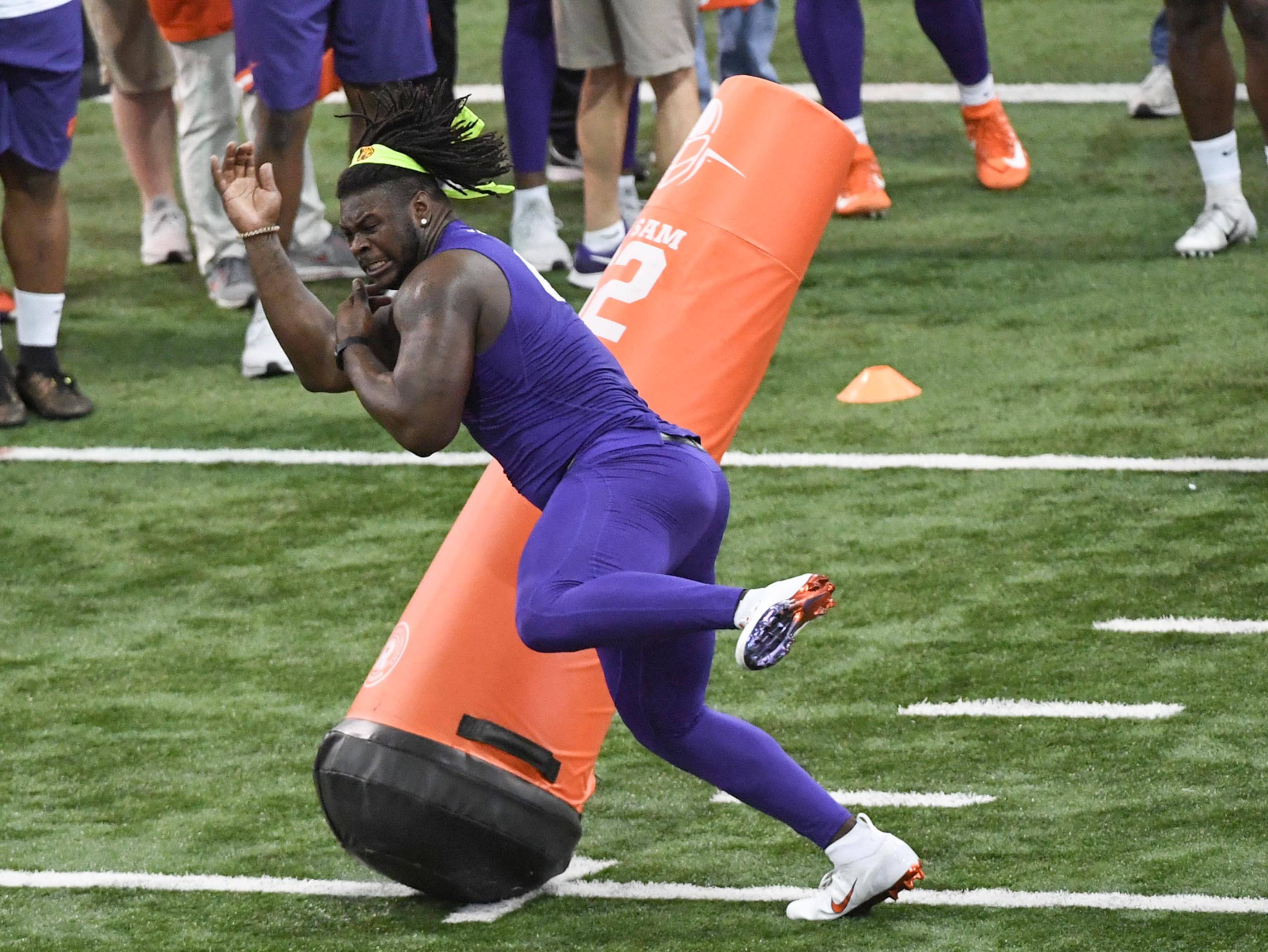 Defensive lineman Albert Huggins Jr. shows skills to scouts during Clemson pro day at the Poe Indoor Facility in Clemson Thursday, March 14, 2019.