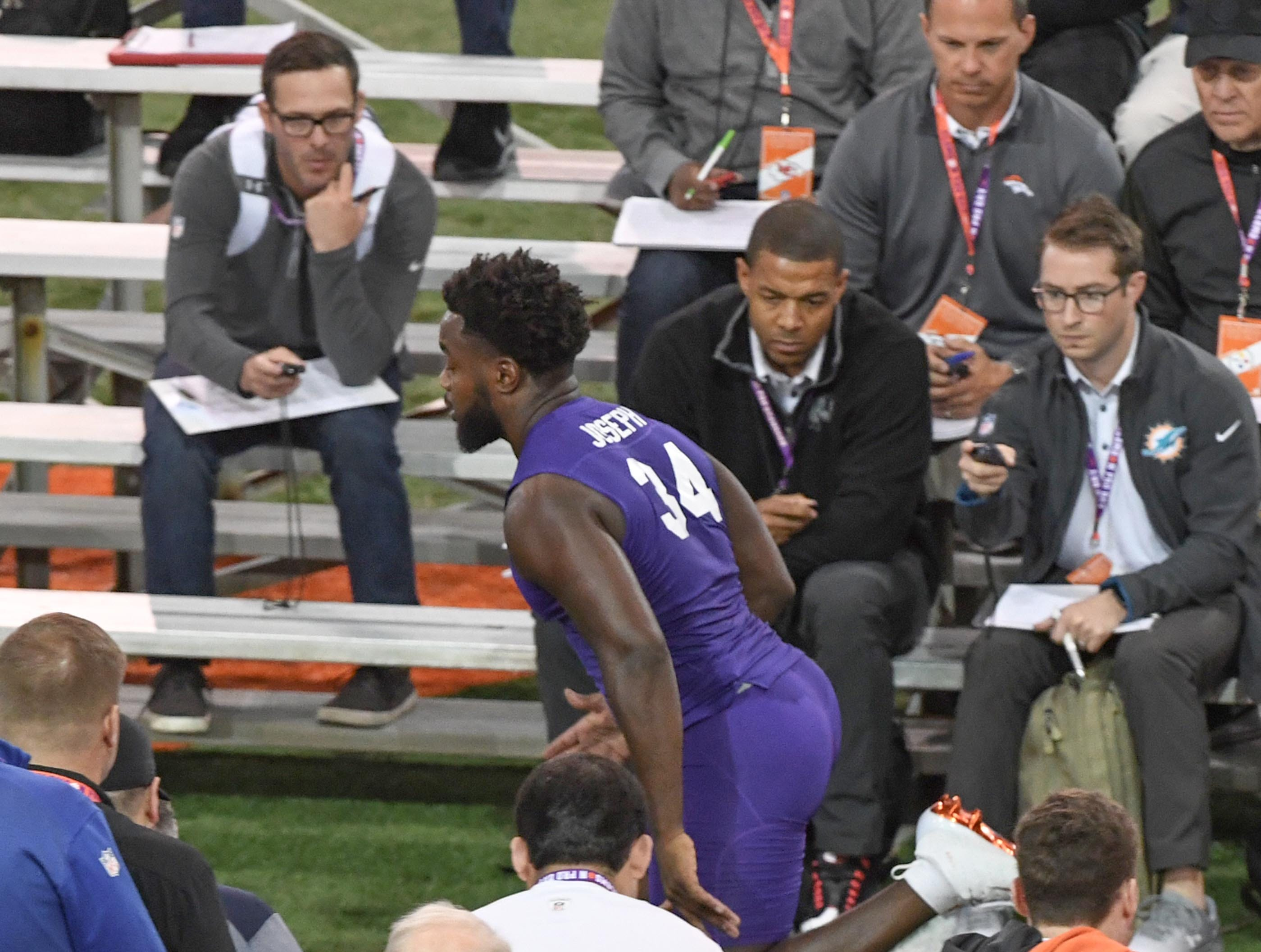Pro scouts time Linebacker Kendall Joseph during Clemson pro day at the Poe Indoor Facility in Clemson Thursday, March 14, 2019.