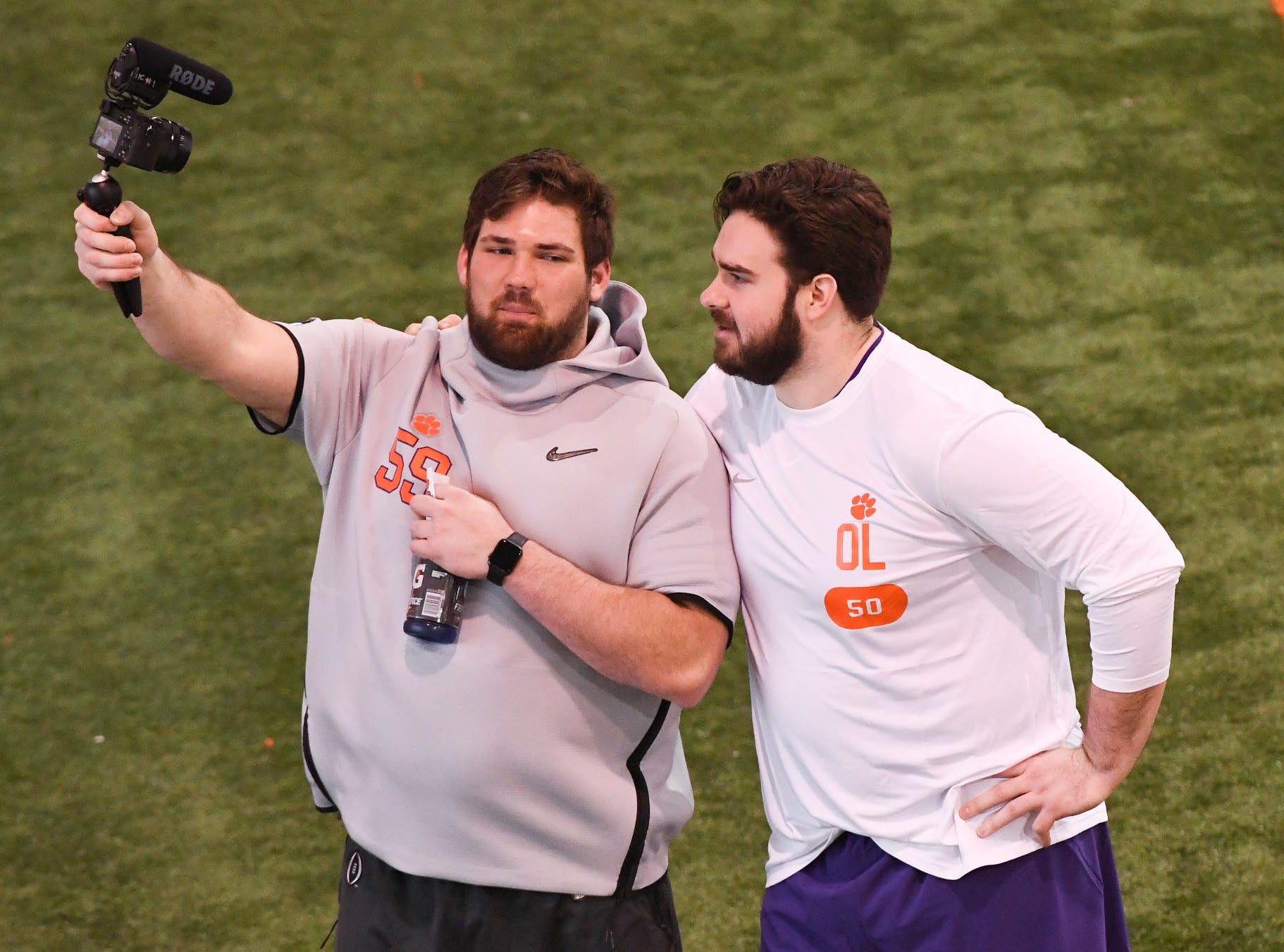 Clemson lineman Gage Cervenka, left, get video of himself and pro prospect offensive lineman Justin Falcenli during Clemson pro day at the Poe Indoor Facility in Clemson Thursday, March 14, 2019.