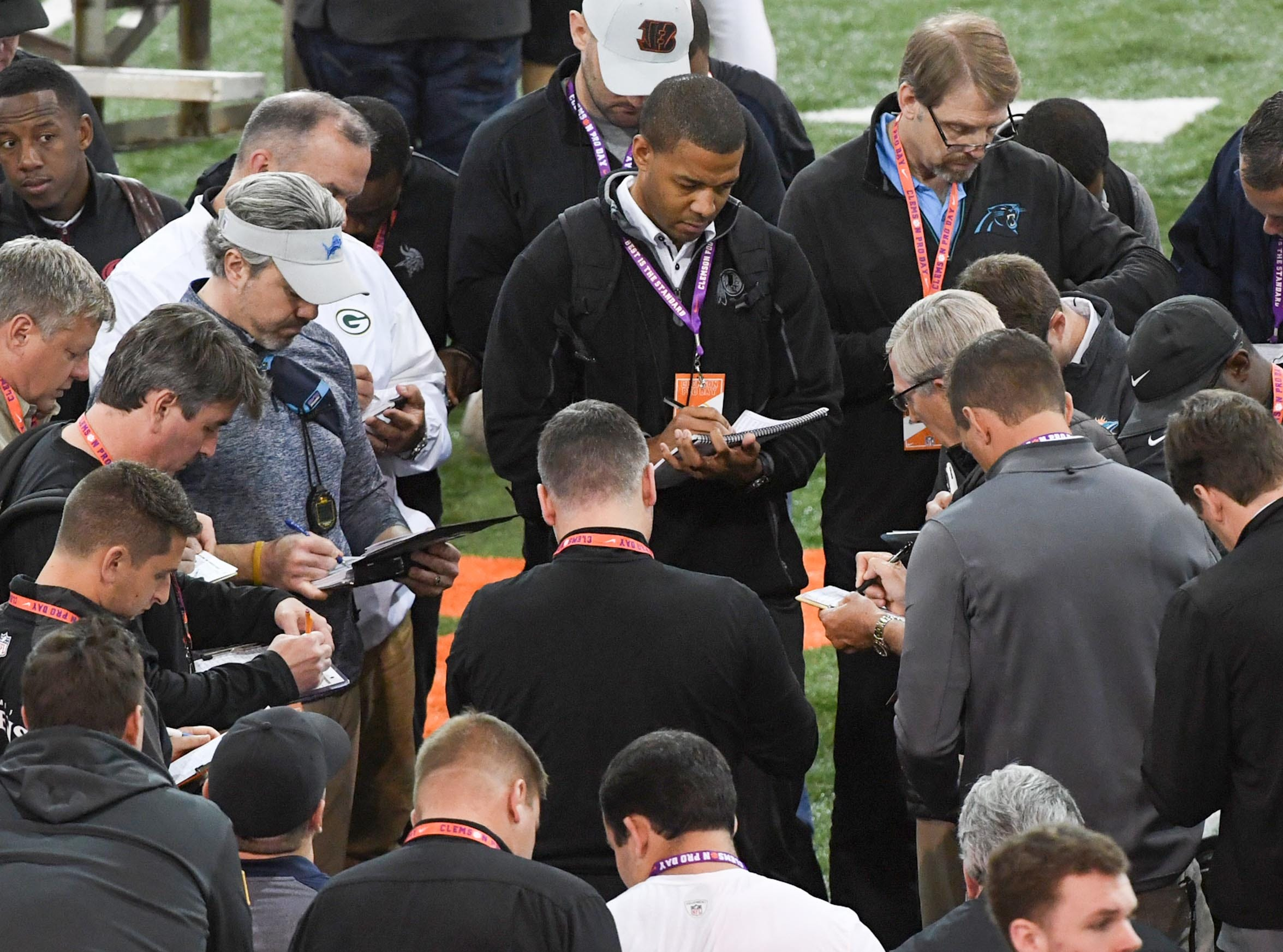 NFL scouts gather during Clemson pro day at the Poe Indoor Facility in Clemson Thursday, March 14, 2019.