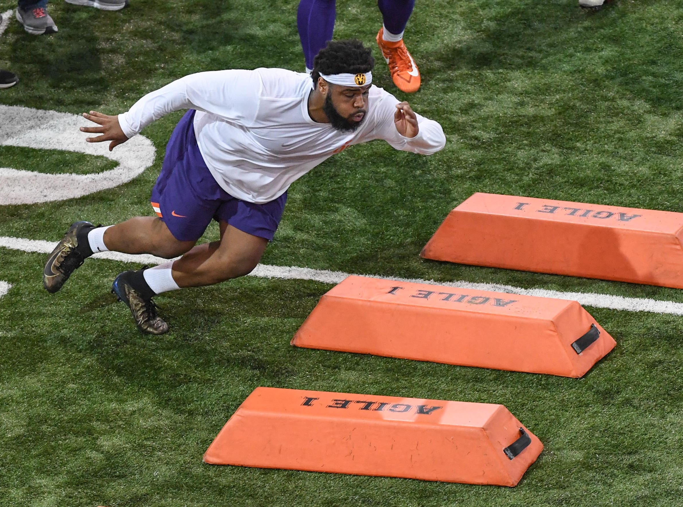 Defensive lineman Christian Wilkins runs through barriers during Clemson pro day at the Poe Indoor Facility in Clemson Thursday, March 14, 2019.