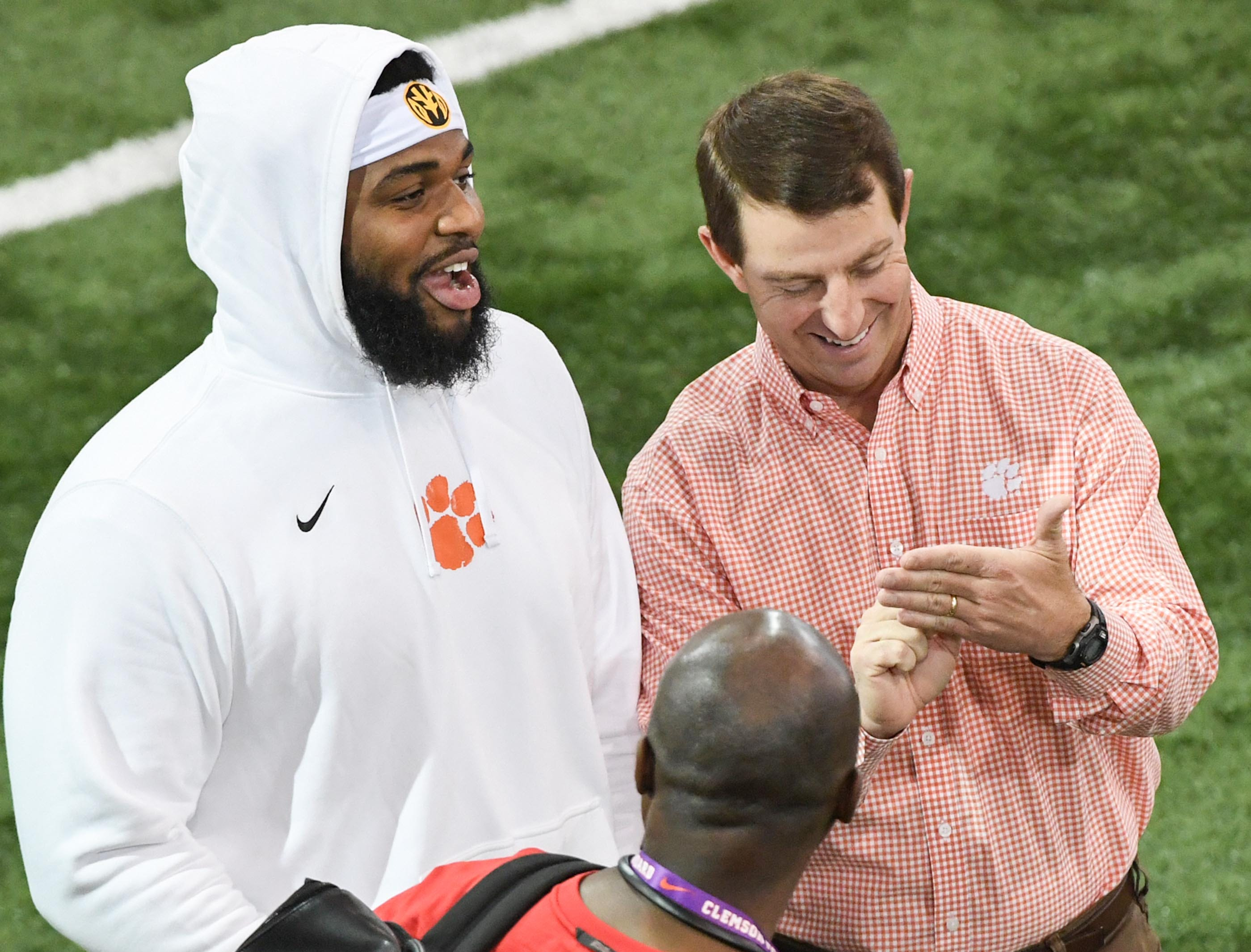Defensive lineman Christian Wilkins and Clemson head coach Dabo Swinney talk during Clemson pro day at the Poe Indoor Facility in Clemson Thursday, March 14, 2019.