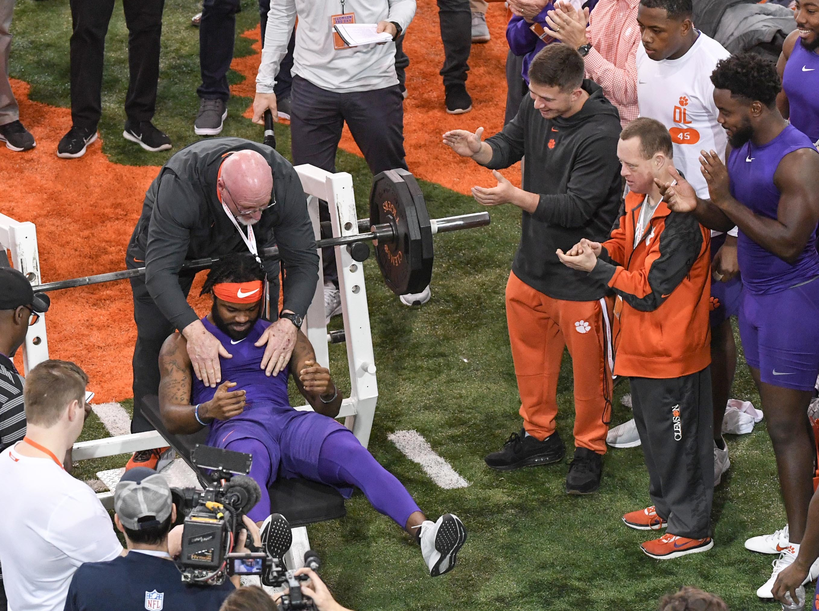 Wide receiver Trevion Thompson finishes a bench press test with 16 reps of 225 pounds during Clemson pro day at the Poe Indoor Facility in Clemson Thursday, March 14, 2019.