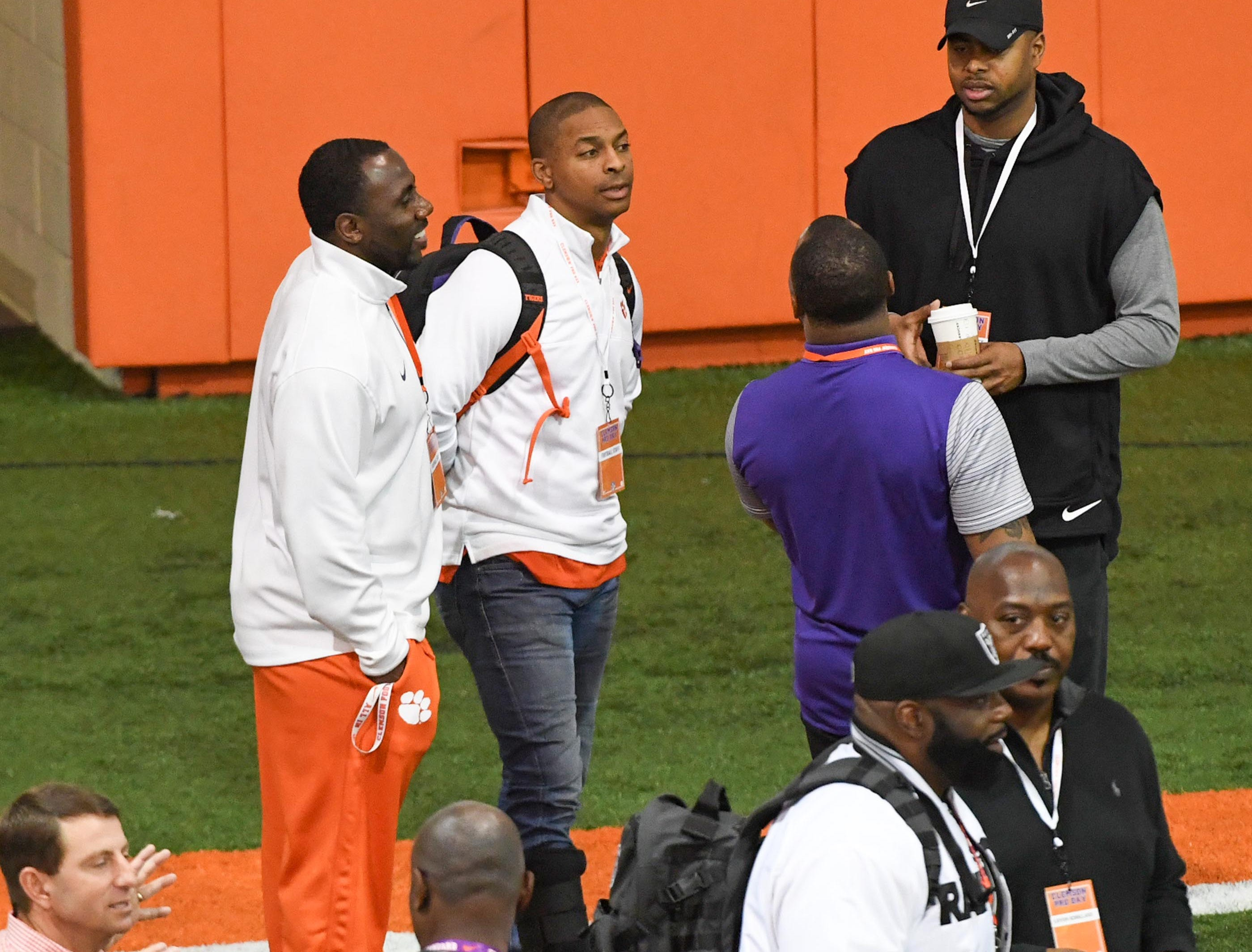 CJ Spiller , left, watches during Clemson pro day at the Poe Indoor Facility in Clemson Thursday, March 14, 2019.