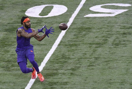 Wide receiver Trevion Thompson catches a ball in a route drill during Clemson pro day at the Poe Indoor Facility in Clemson Thursday, March 14, 2019.