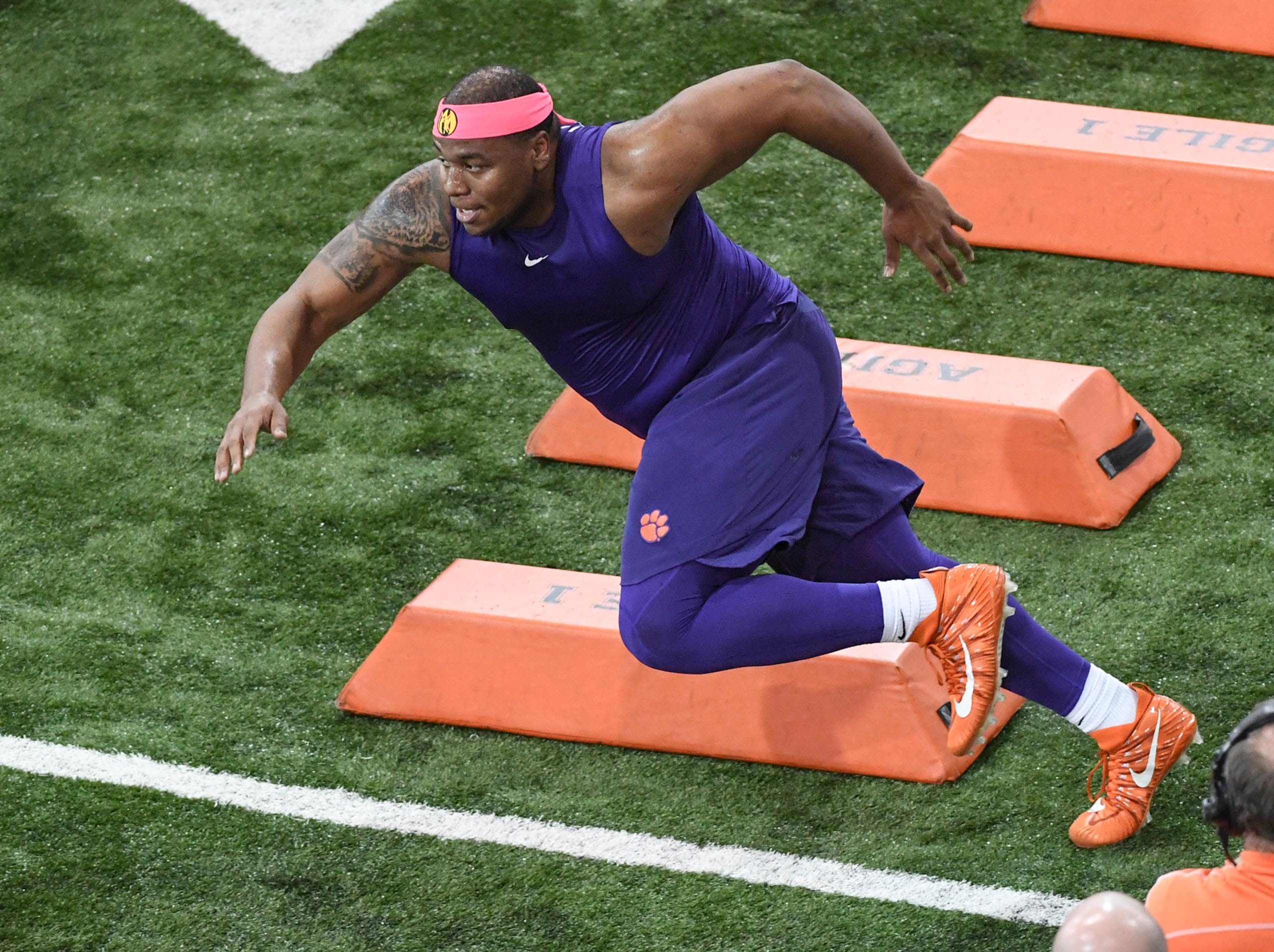 Defensive lineman Dexter Lawrence runs through barriers during Clemson pro day at the Poe Indoor Facility in Clemson Thursday, March 14, 2019.