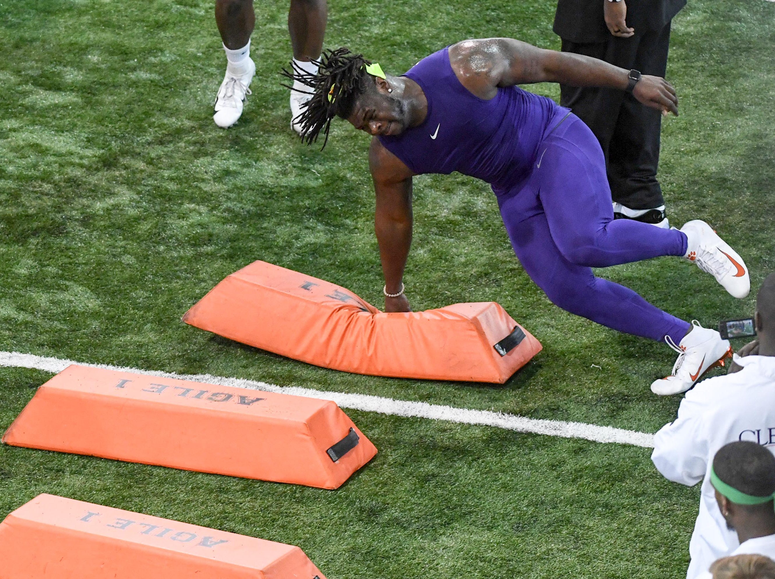 Defensive lineman Albert Huggins Jr. runs during Clemson pro day at the Poe Indoor Facility in Clemson Thursday, March 14, 2019.