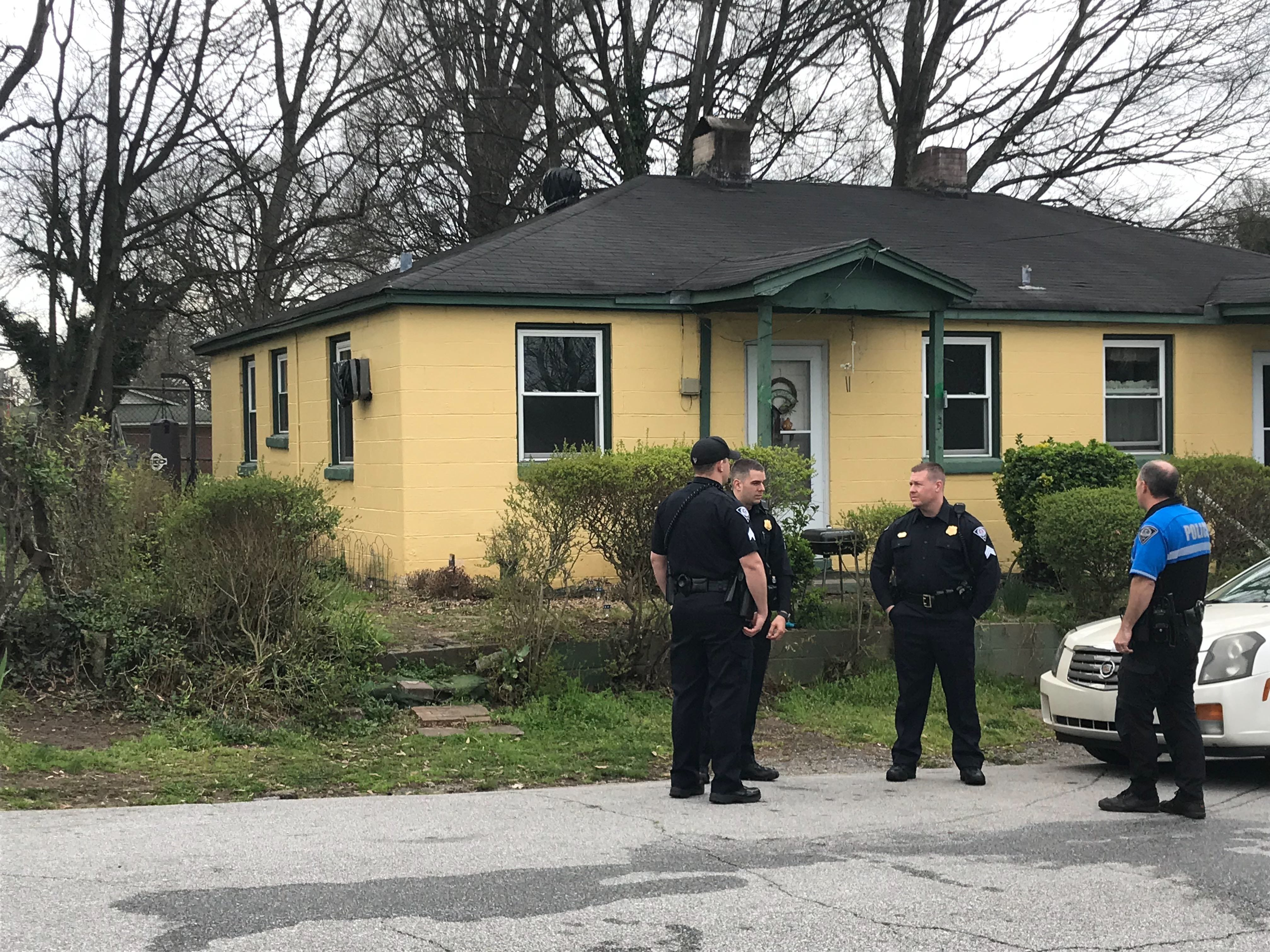 Police at the scene of an apparent attack by dogs in Greenville's Trescott Street on Thursday, March 14, 2019