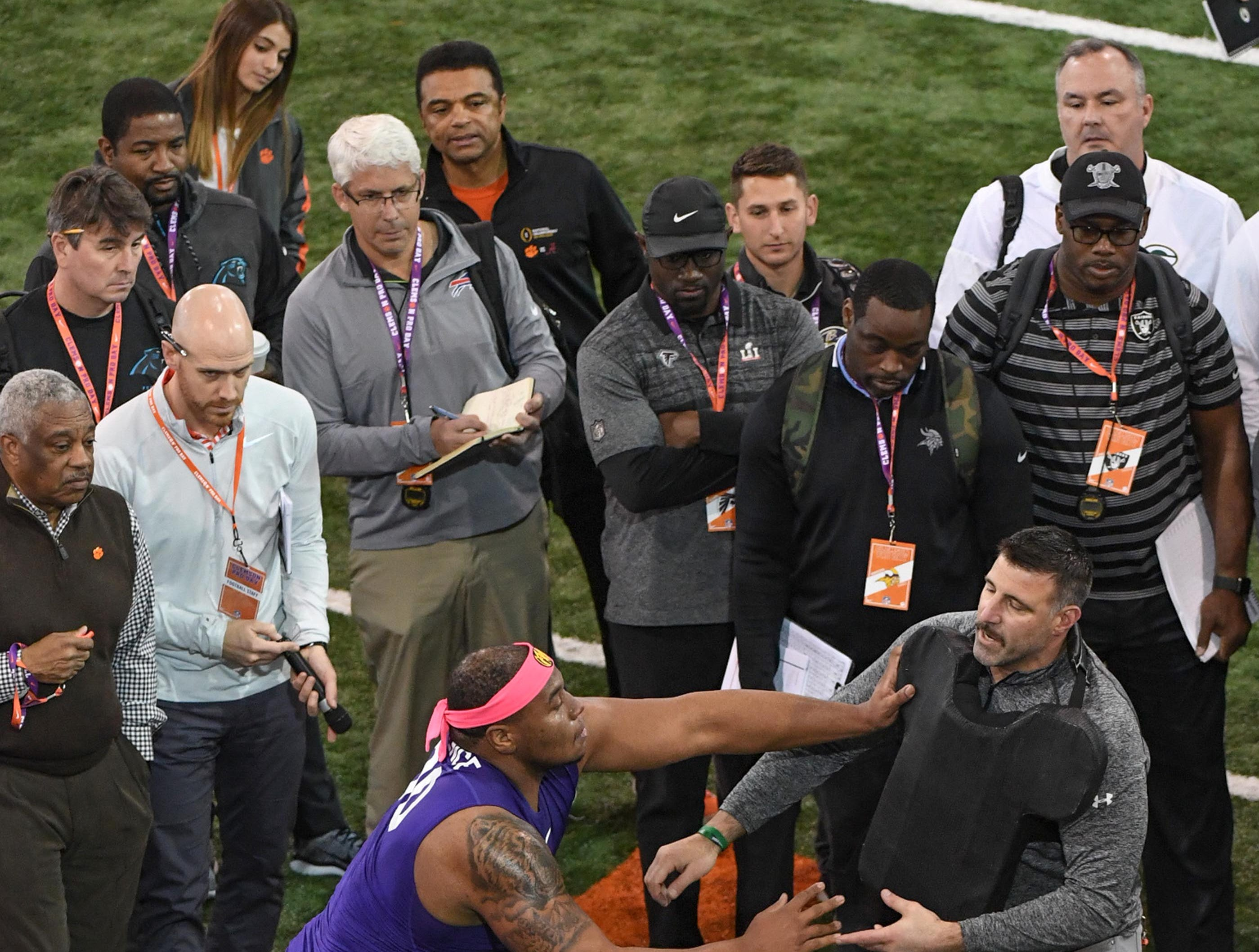 Defensive lineman Dexter Lawrence is observed by pro scouts in a blocking drill with Tennessee coach Mike Vrabel during Clemson pro day at the Poe Indoor Facility in Clemson Thursday, March 14, 2019.