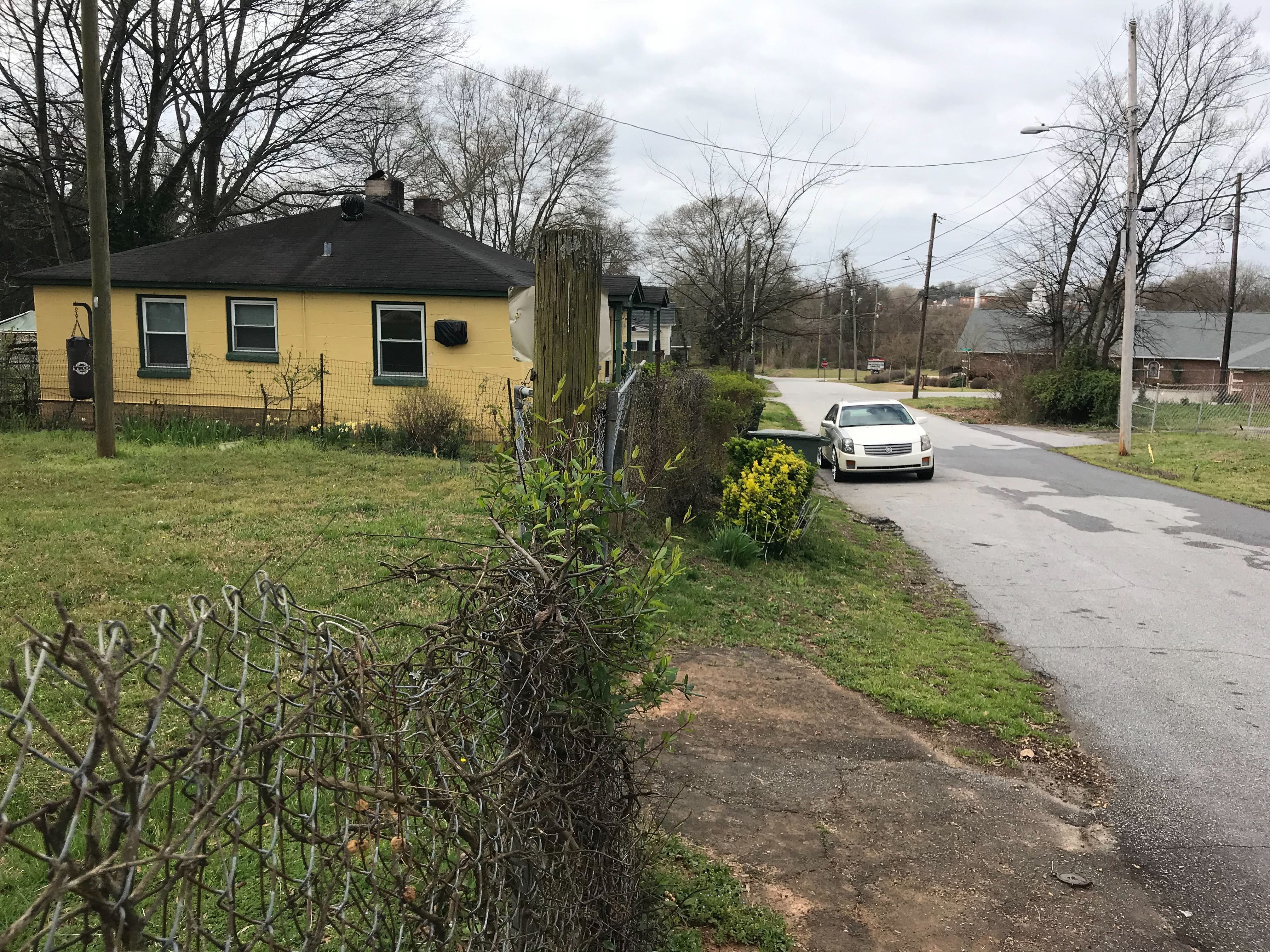 Police at the scene of an apparent attack by dogs in Greenville's Trescott Street on Thursday, March 14, 2019, that left an elderly couple injured