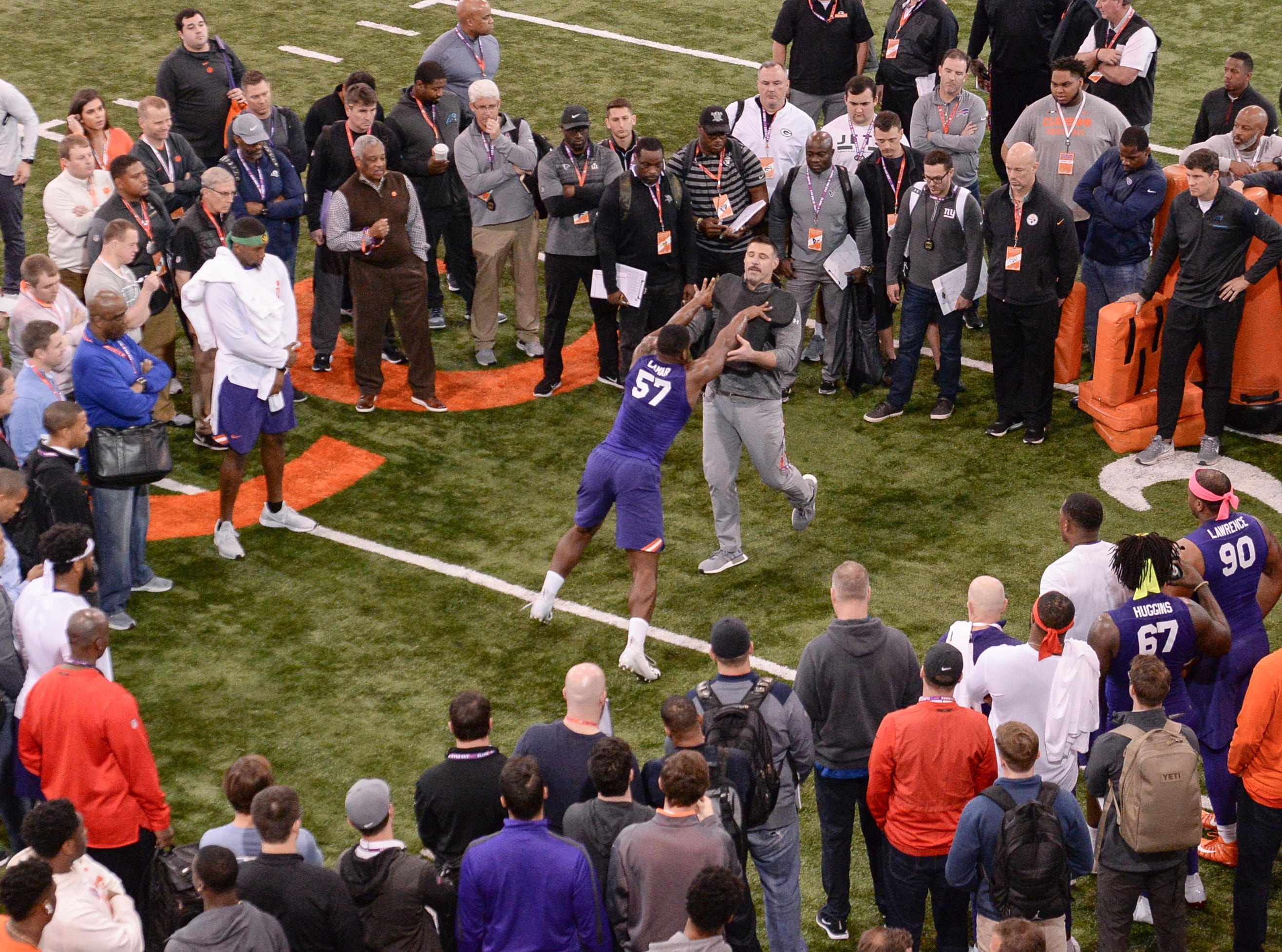 Defender Tre Lamar III pushes off Tennessee head coach Mike Vrabel in a drill during Clemson pro day at the Poe Indoor Facility in Clemson Thursday, March 14, 2019.