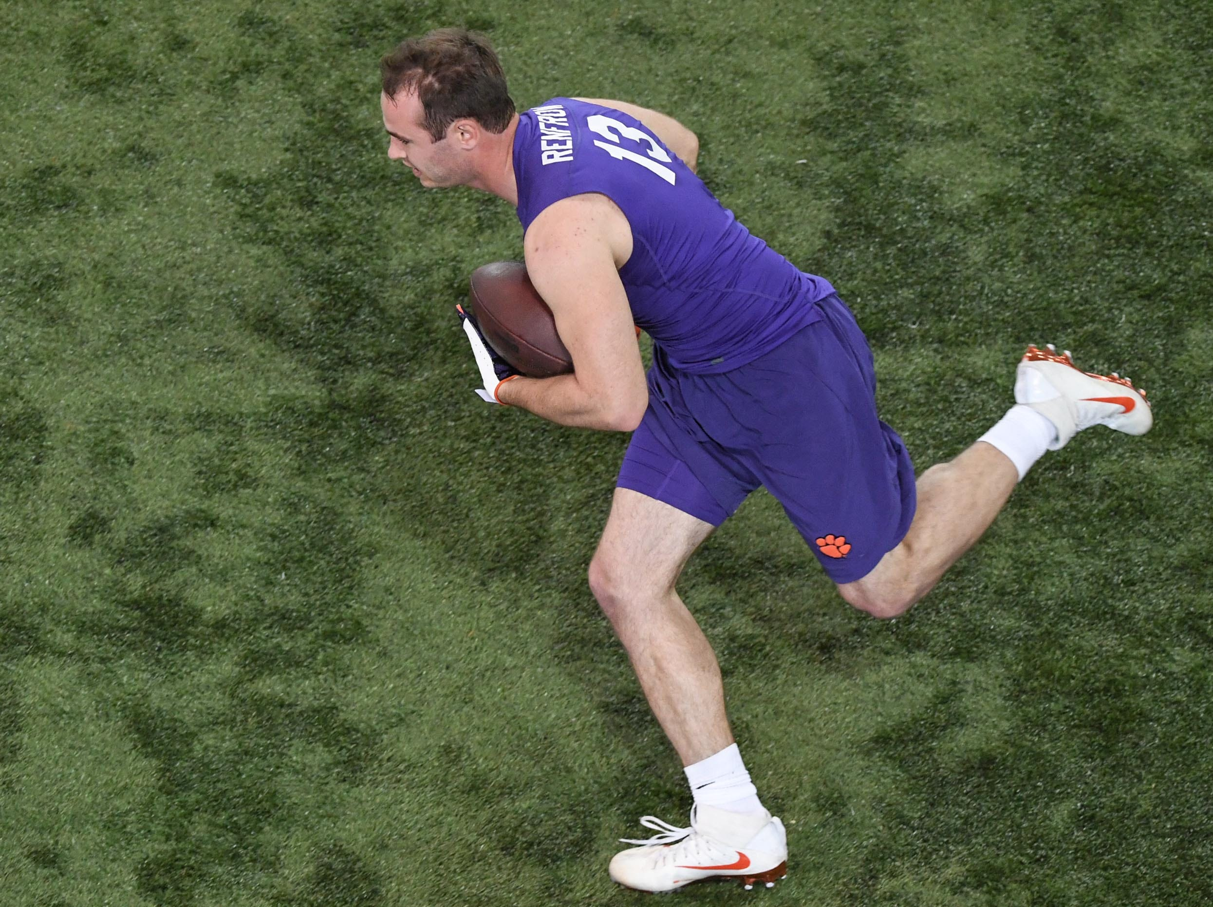 Wide receiver Hunter Renfrow runs after a catch during Clemson pro day at the Poe Indoor Facility in Clemson Thursday, March 14, 2019.