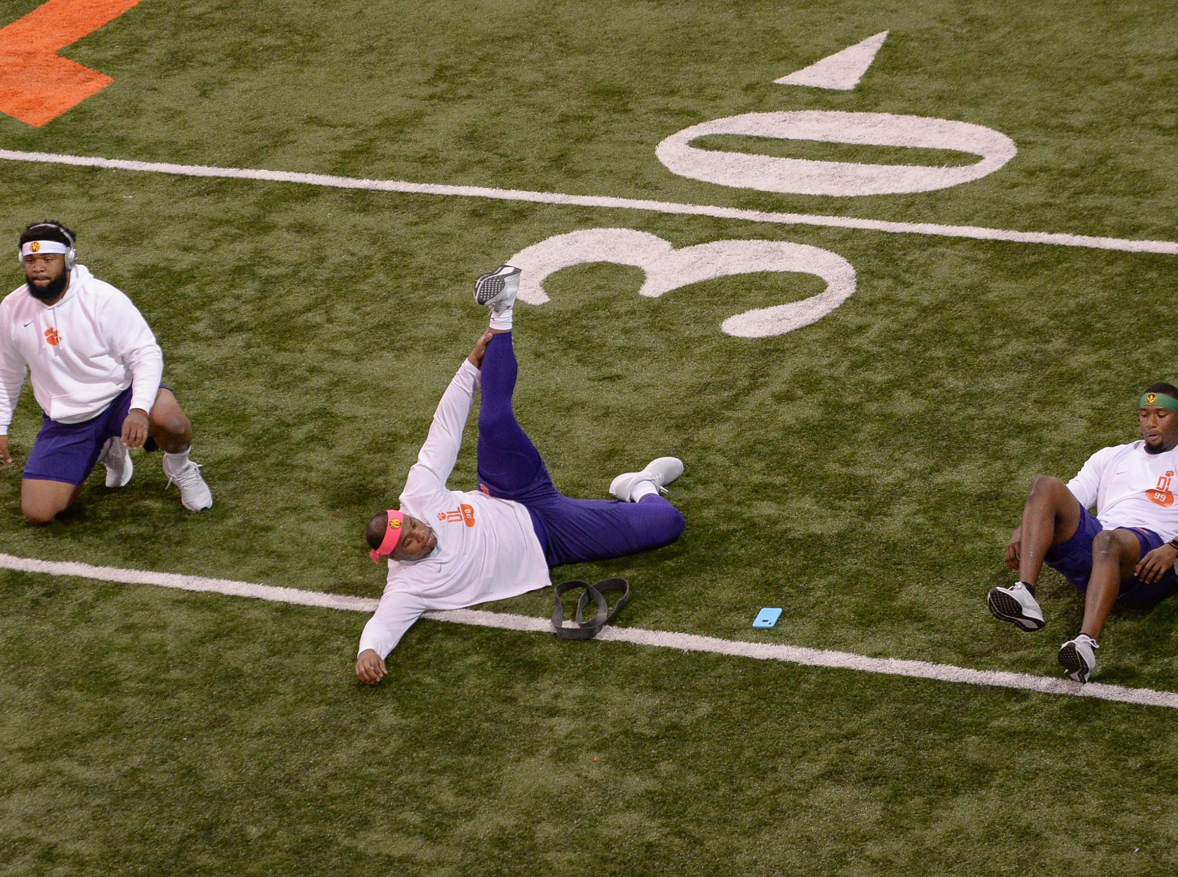 Defensive lineman Christian Wilkins, left, Defensive lineman Dexter Lawrence, and Defensive end Clelin Ferrell stretch before Clemson pro day at the Poe Indoor Facility in Clemson Thursday, March 14, 2019.