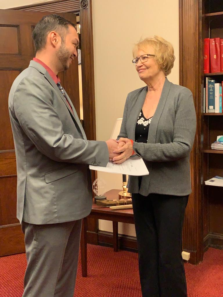 Del. Mike San Nicolas on Wednesday shakes hands with Sheila Kilpatrick, wife of the late Navy veteran Lonnie Kilpatrick, the namesake of a bill that seeks to grant presumptive herbicide exposure status to U.S. service members who served on Guam, CNMI, American Samoa and Johnston Atoll.