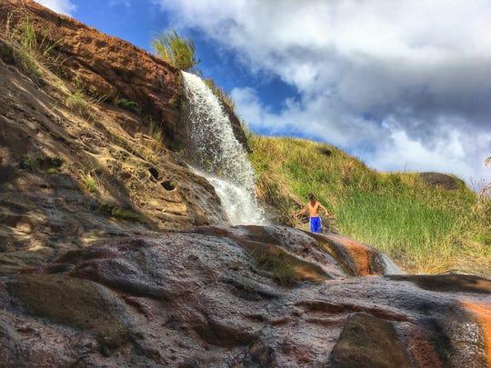 Photo of Fintasa Falls in Inarajan and Robert Pereda taken March 10, 2019.