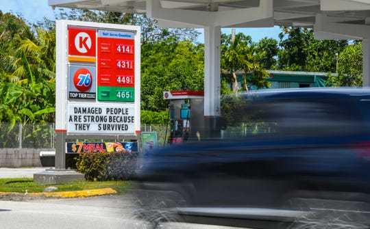 A motorist zips pass a sign reflecting the increase of fifteen-cents for the price of fuel at the Circle K/76 gas station in Agat as seen on Thursday, March 14, 2019. The previous price for regular grade fuel was $4.00.
