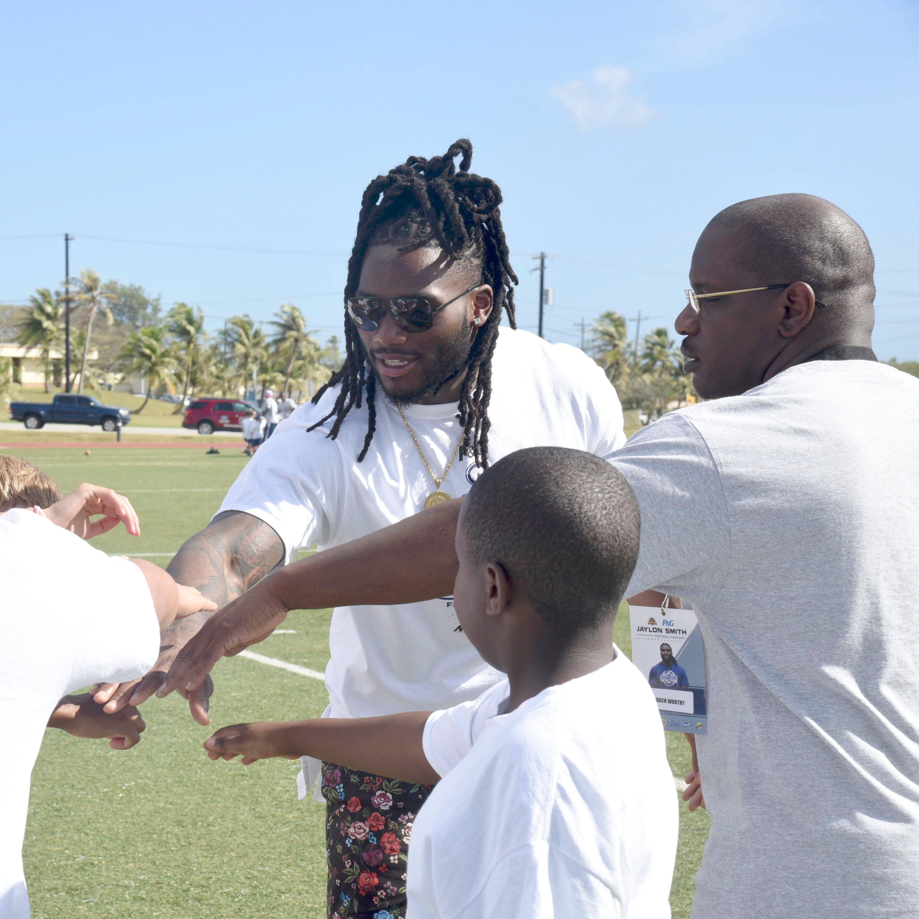 Cowboys linebacker holds football camp on Naval Base Guam