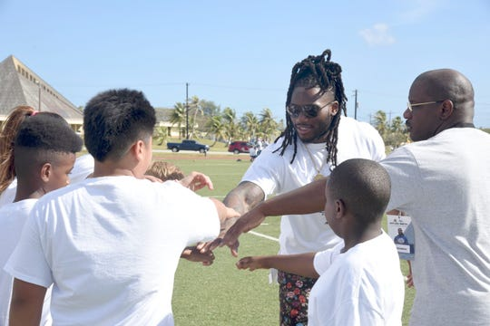 Jaylon Smith, a linebacker for the Dallas Cowboys, leads a team cheer during the Jaylon Smith Football Pro Camp at Blue Jacket Field on March 10.