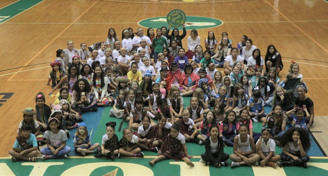 Guam Girl Scouts celebrated World Thinking Day on March 9 at the UOG Calvo Field House. Troops represented countries that are part of the World Association of Girl Guides and Girl Scouts with table displays, cultural dances, costumes, SWAPS, and food samples. Money collected from food samples was donated to the Juliette Low World Friendship Fund, which supports the Girl Scout Program.