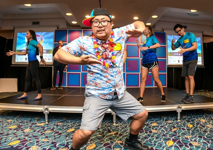 Pacific Islands Club Sales Manager Youngmin Kim shows off his best robot dance moves, along with other mock contestants, during a game show-themed press show to promote the United Airlines Guam Marathon at the PIC resort on Thursday, March 14, 2019. This year's race, featuring a 5km run, 10km run, half-marathon and a full-marathon, is scheduled for April 14.
