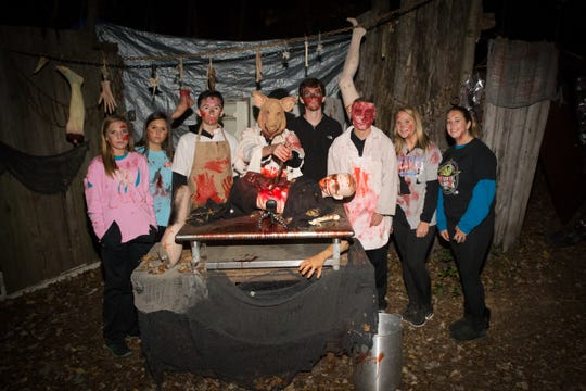 A group of Terror on the Trail cast members proudly pose for a photo. The Terror on the Trail raises money every year for local families in need.