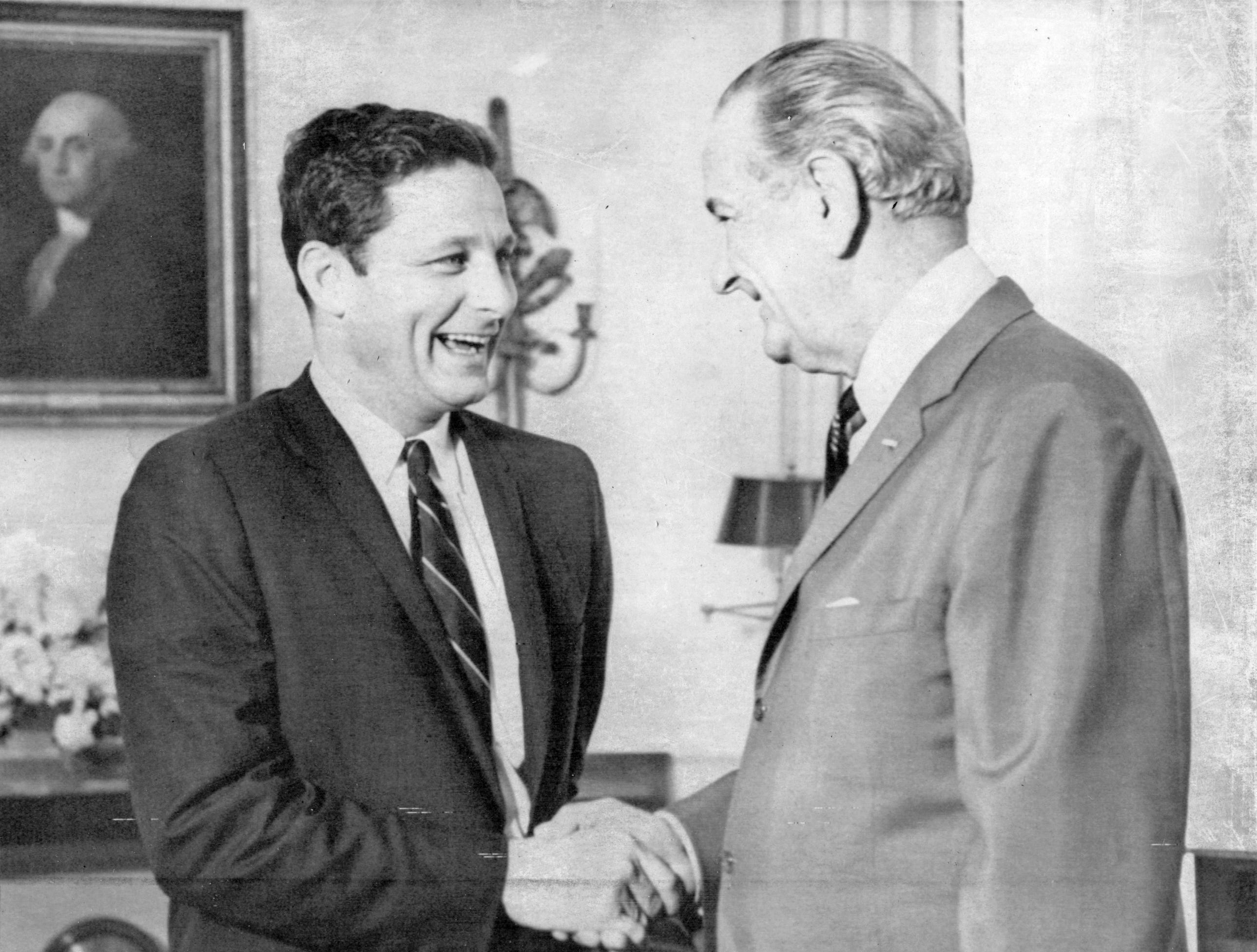 Washington-Sen. Birch Bayh, D-Ind., is greeted by President Johnson as he visited the White House on Nov. 8, 1968.  He earlier told a news conference he believed the election of the president by popular vote would strengthen rather than weaken the two-party system. Bayh was chief sponsor of a constitutional amendment providing for the election of the president and vice president by popular vote.